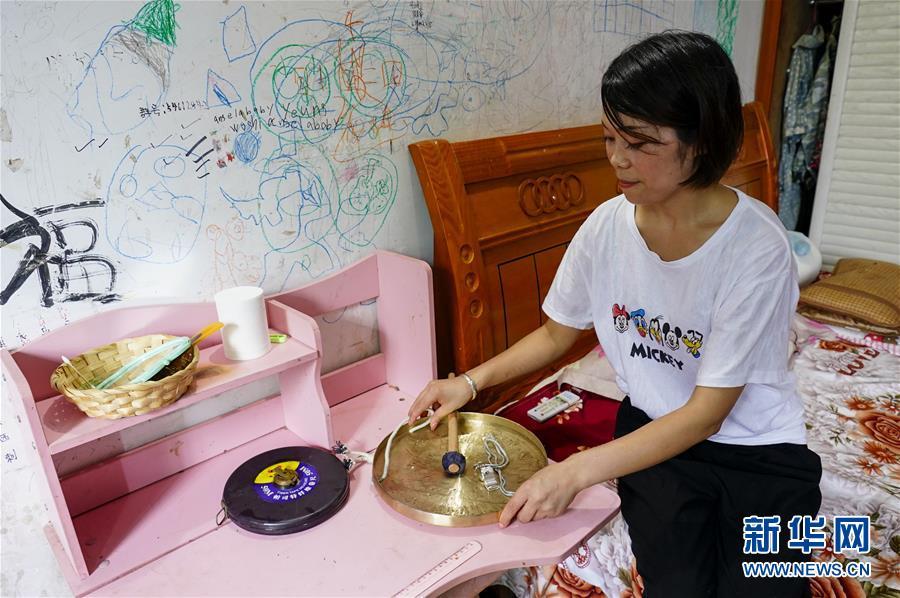 (圖片故事)(8)重慶永川:雨中逆行者 守護百姓安全的地質災害監測員