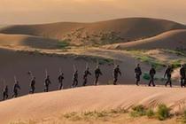 """徵戰""""死亡之海""""的綠色使者——內蒙古杭錦旗人武部在庫布其沙漠開展生態扶貧記事"""