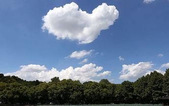 """西湖斷橋上空飄來一朵""""愛心""""雲"""